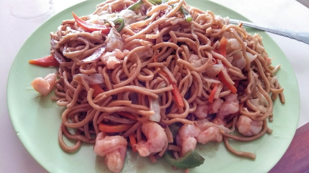 A huge plate of shrimp chow mein from one of the Chinese restaurants in Orange Walk Belize