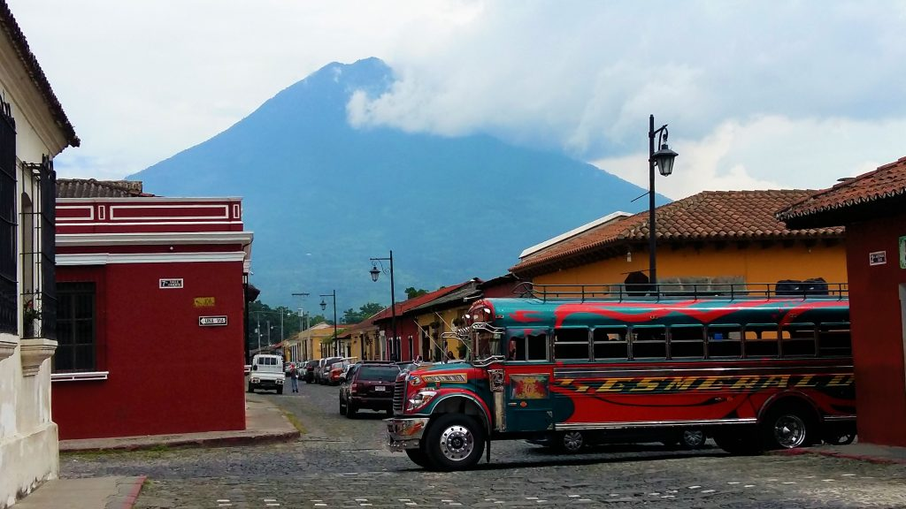 A Chicken Bus and Agua Volcano in Antigua Guatemala - Backpacking on a Budget