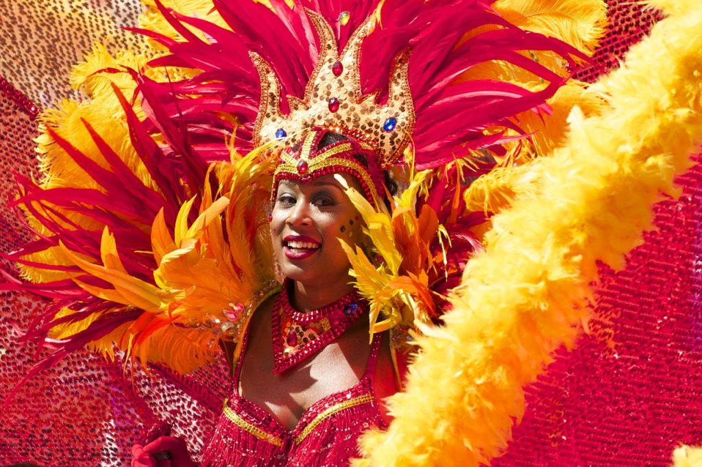 Backpacking South America - Carnival performer with red and yellow feathers