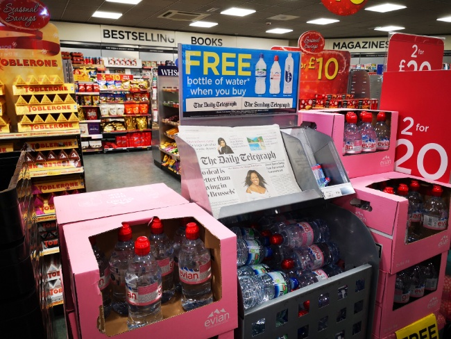 Offers such as giving a free bottle of water with a newspaper are not uncommon at airports