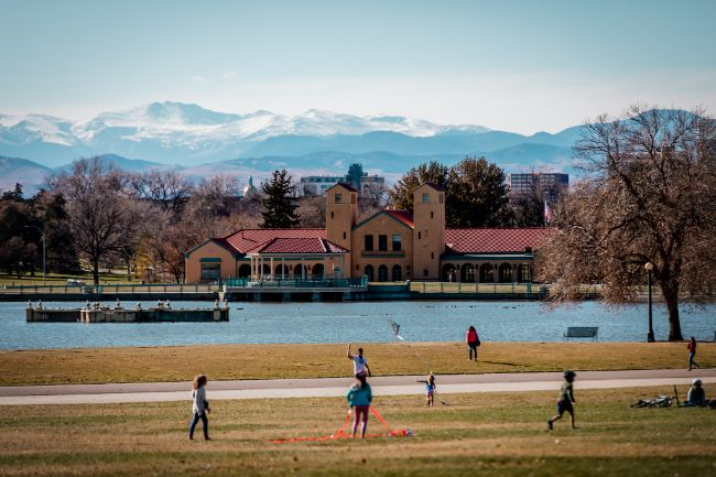 City Park in Denver Colorado with kids playing and mountains in the distance