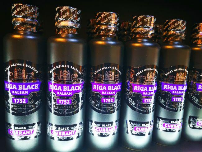 Black bottles of Riga Black Balzam with purple writing on the label