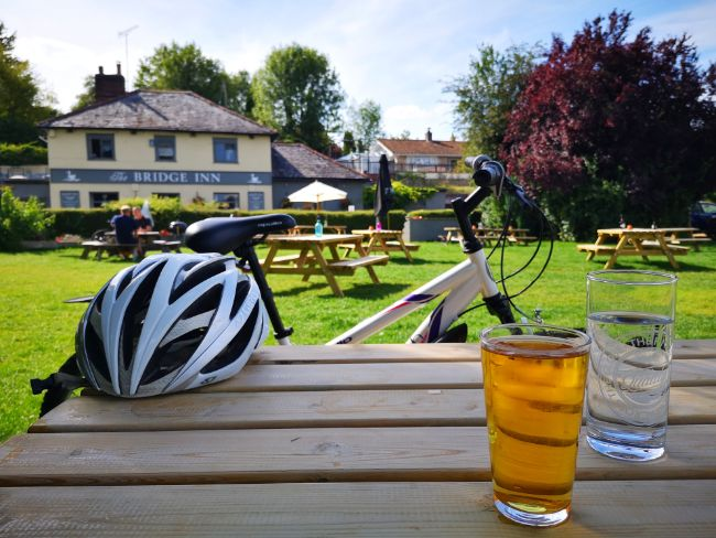 Enjoying a Drink at a Pub During a Bike Ride