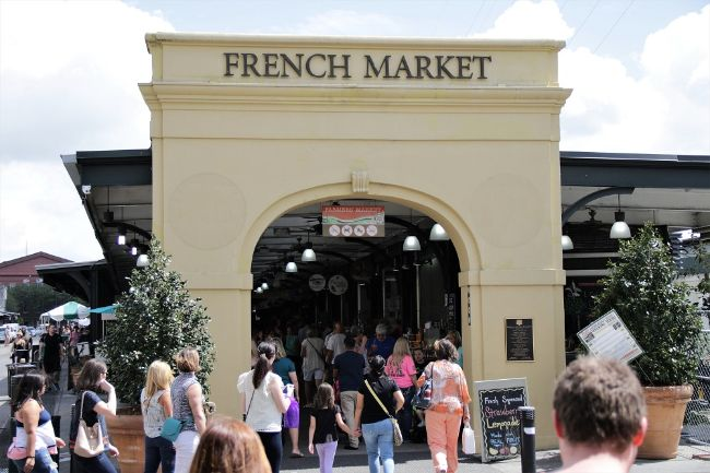 The archway entrance of New Orleans French Market - That Texas Couple